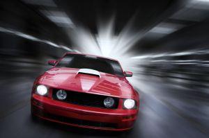 14420644 - luxury red sport car speeding in a underground parking garage