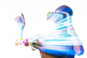 49996044 - double exposure of man using the virtual reality headset
